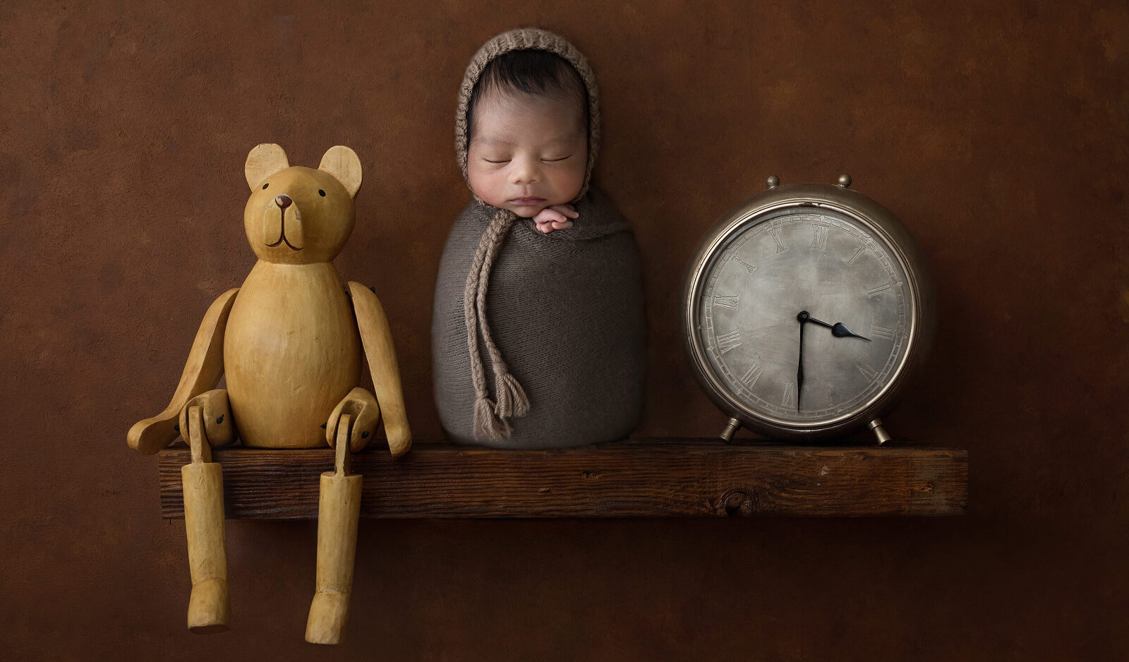 Darwin Photographer little cherub newborn baby, clock, teddy